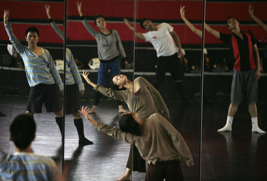 Members of the Beijing Modern Dance Company attend a training session led by creative director Gao Yanjinzi at a gym in Beijing