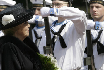 Netherlands' Queen Beatrix inspects honour guards during an official welcoming ceremony in Tallinn