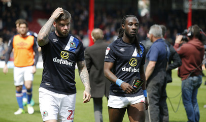 Blackburn Rovers Danny Guthrie and Marvin Emnes looks dejected after relegation