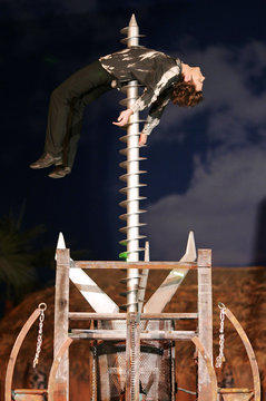 German illusionist Jan Rouven poses on a mining drill during his new show at Tropical Islands holiday resort near Brand