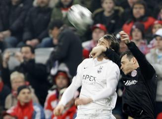 Bayern Munich's Sagnol is tackled by Aberdeen's Miller during UEFA Cup third round soccer match in Munich
