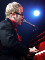 "Elton John performs during a VIP party celebrating the launch of his ""Dream Ticket"" DVD collection a.."