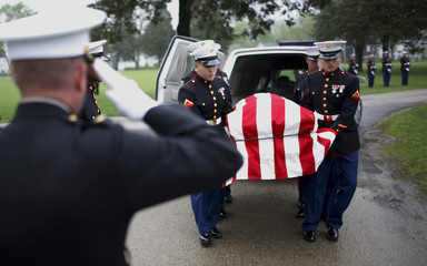 U.S. Marine honor guard carry the body of Lance Coporal Jesse D. Delatorre to graveside services in Montgomery