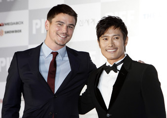 Actors Hartnett and Lee from the film I Come with the Rain arrive at the opening ceremony of the 14th Pusan International Film Festival in Busan
