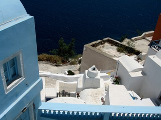 Roofs of the island of Santorini/View of the roofs and walls of buildings in Santorini, Greece, Cyclades. Typical white and blue architecture. From travels in the Mediterranean