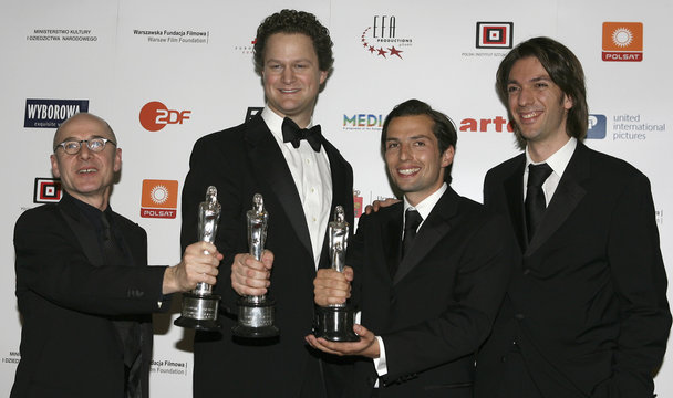 Best actor Muhe, best screenwriter von Donnersmarck, best film producers Berg and Wiedemann pose with their awards for 'The Lives Of Others' after European Film Awards in Warsaw