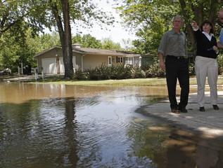 U.S. President George W. Bush gets a tour of the flood damage from Iowa City Mayor Regenia Bailey in Iowa City, Iowa
