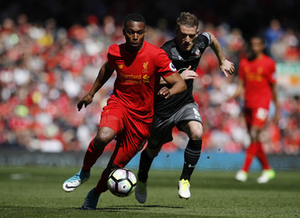 Liverpool's Daniel Sturridge in action with Southampton's Steven Davis