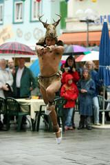 Ecuadorean dancers representing the hunting of a deer perform at main square in Bad Kissingen
