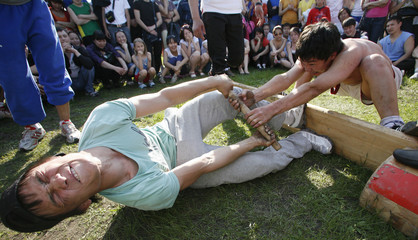 Students compete  in the traditional Yakutian stick-wrestling in the Siberian city of Krasnoyarsk