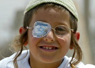 A Jewish boy wears a patch featuring Israeli flag.