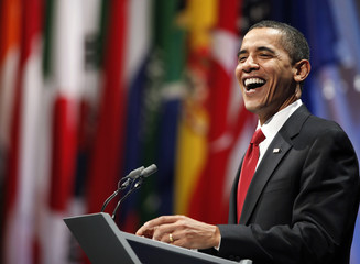 U.S. President Barack Obama laughs during a news conference after the G20 summit at the ExCel centre in east London