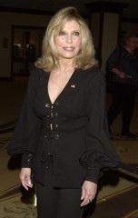 Singer Nancy Sinatra poses upon arriving at the 46th annual Thalians Ball October 13, 2001 in Los An..