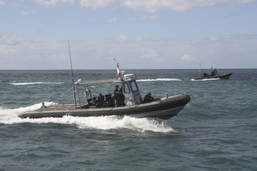Lebanese customs officers perform maneouvers in a patrol boat off the coast of Lebanon