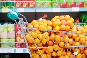 Kaluga, Russia - April, 21, 2017: Interior of a supermarket in Kaluga, Russia with basket with mandarins on a frontground