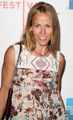 Sheryl Crow poses for pictures at the Tribeca Film Festival in New York.