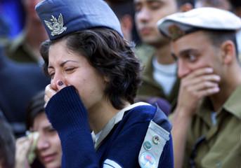 Friends of Israeli soldier Nir Heftzadi, slain in a Palestinian suicide bombing, weep at his funeral..