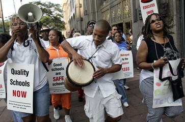 Striking Detroit Public School teacher Richardson drums as teachers protest lack of union contract in Detroit