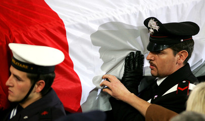 The coffin of slain Italian intelligence officer Nicola Calipari is carried by members of Italy's ...