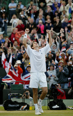BRITAIN'S HENMAN SHOWS HIS RELIEF AFTER DEFEATING SWITZERLAND'SKRATOCHVIL AT THE WIMBLEDON TENNIS ...