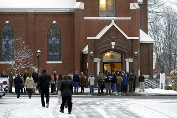 Mourners line up outside St. Joseph's Church in Rice Lake at visitation for Crotteau father and son.