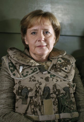 German Chancellor Angela Merkel wears a flak jacket during her helicopter flight to the German ISAF headquarters in Masar-i-Sharif north of Kabul