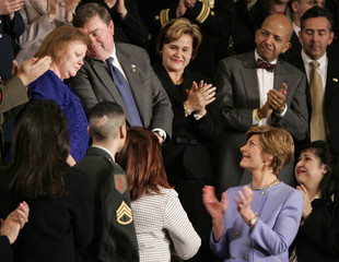 First lady Laura Bush applauds parents of fallen Marine during State of the Union address.