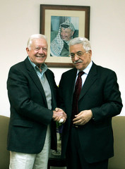 Newly elected Palestinian President Mahmoud Abbas meets with former U.S. president Jimmy Carter in ...