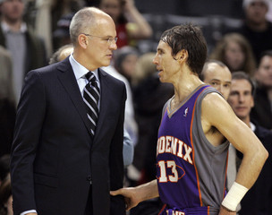 Toronto Raptors head coach Triano talks to Phoenix Suns guard Nash at the end of their NBA basketball game in Toronto