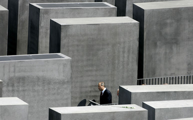 Israel's Foreign Minister Silvan Shalom walks between the Holocaust memorial in Berlin.