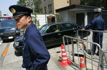 Japanese police officers stand guard at the entrance of the Chinese embassy in Tokyo.
