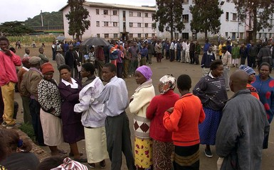 HARARE RESIDENTS QUEUE OUTSIDE A POLLING STATION FOR ZIMBABWEANPRESIDENTIAL ELECTIONS.