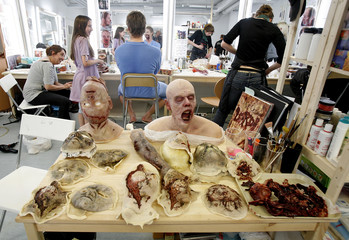 Props are laid out on a table in the makeup room on the set of the horror movie 'Dark Floors' in Oulu