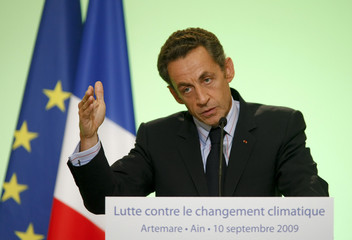 France's President Nicolas Sarkozy  delivers a speech on carbon tax during a trip in Artemare