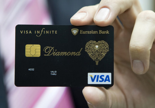 Executive Director of Eurasian Bank, Nikolin, shows a new VISA card encrusted with diamond and laced with an elaborate gold pattern in Almaty