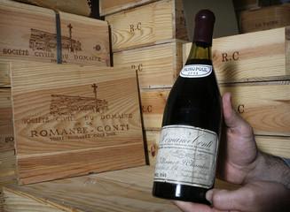 Christie's auction house wine specialist Michael Ganne displays a bottle of Romanee-Conti 1945 in Geneva