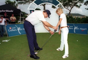 SINGER GERI HALLIWELL GIVEN GOLF LESSON BY NICK FALDO IN SINGAPORE.