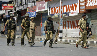 Indian police in riot gear patrol deserted street to stop anti-India march in Srinagar