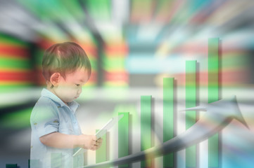 Motion blur of asian kid start to learn about invest with tablet in his hand on blurred stock board background in investment concept