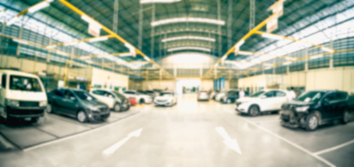 Car repair service centre in blurred background.