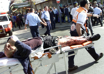 AN INJURED MAN IS RUSHED TO AMBULANCE AFTER AN EXPLOSION IN THE CENTREOF JERUSALEM.