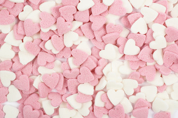 Surface coated with heart shaped sprinkles