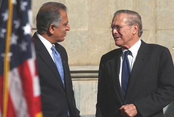 U.S. Secretary of Defense Donald Rumsfeld talks to U.S. Ambassador and Special Presidential ...