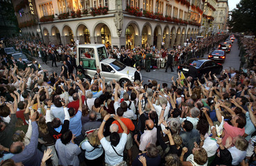Pope Benedict XVI waves to pilgrims as he travels in his Popemobile during his visit to Munich
