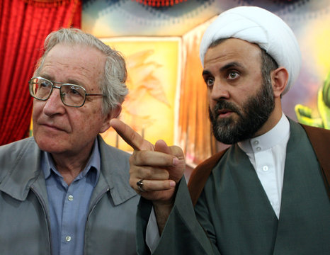 Academic and linguist Noam Chomsky speaks with Hizbollah official Sheikh Nabil Kawook in south Lebanon