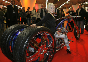 German singer Jeanette Biedermann poses on a trike of Rat's Hole Custom Bike Show during the opening of the Essen Motor Show in Essen