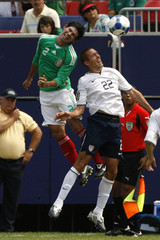 Mexico's Magallon and Arnaud of the U.S. go up for the ball during their CONCACAF Gold Cup final soccer match in East Rutherford, New Jersey
