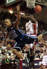 WILLIAMS OF DUKE IS FOULED BY BRYANT OF BOSTON COLLEGE.