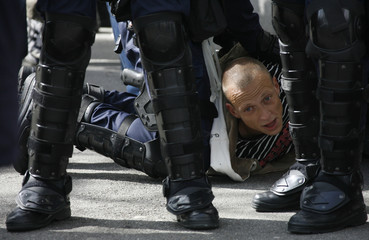 Swiss riot police officers detain a protester during May Day clashes in Zurich