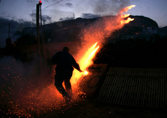 Man ignites rockets during Greek Orthodox Easter celebrations on Aegean island of Chios.